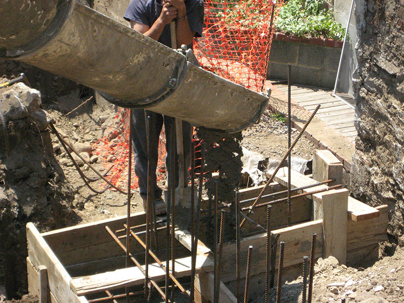 cement being poured into framing