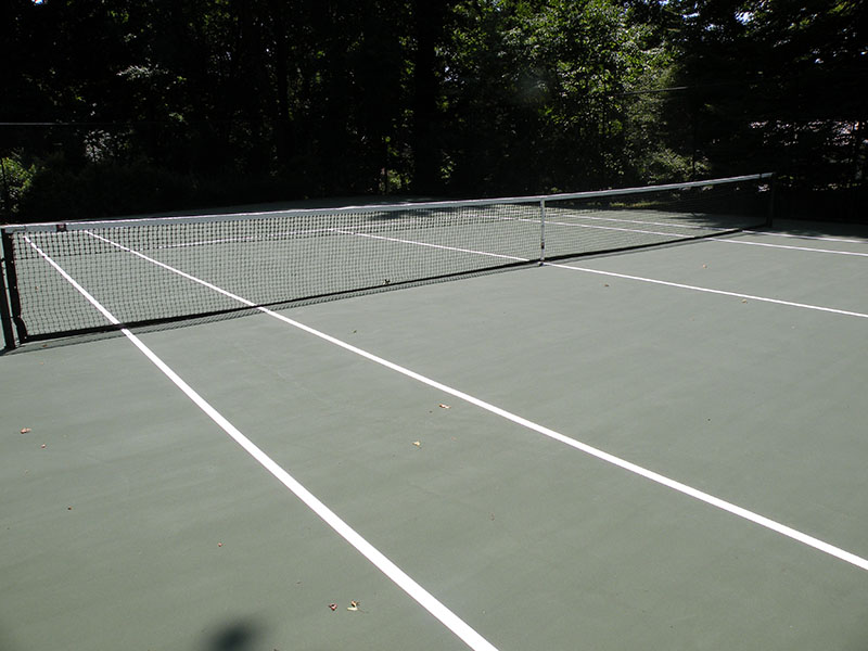 finished tennis court in backyard